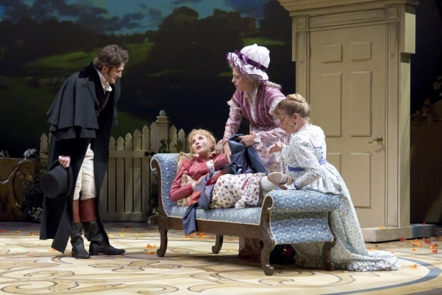 Having rescued her from a fall, Willoughby (Michael Scott McLean) introduces himself to Marianne (Katie Fabel), as Mrs. Jennings (Stacy Ross) and Elinor (Jennifer Le Blanc) care for her ankle.