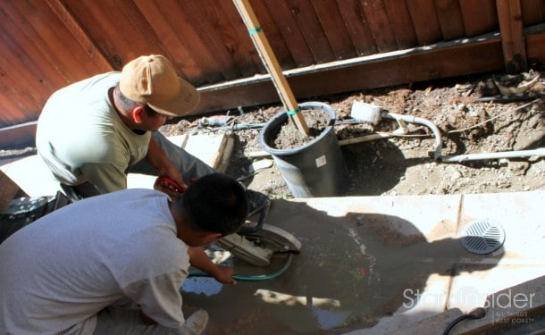 Contractors using a circular saw with concrete blade to cut the concrete. Water from a hose was used to keep the dust under control.