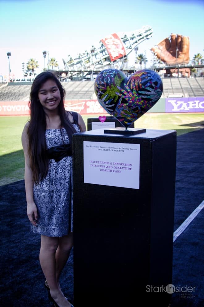 "Lori Chinn, 15, became the youngest artist ever chosen to participate in the public art exhibition. Her work ""Hands of Diversity"" was one of 14 works on display at AT&T Field."