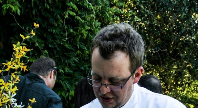 Executive Chef Chris Schloss (Cin-Cin) garnishes a dish on the front Veranda at the historic villa at Montalvo.