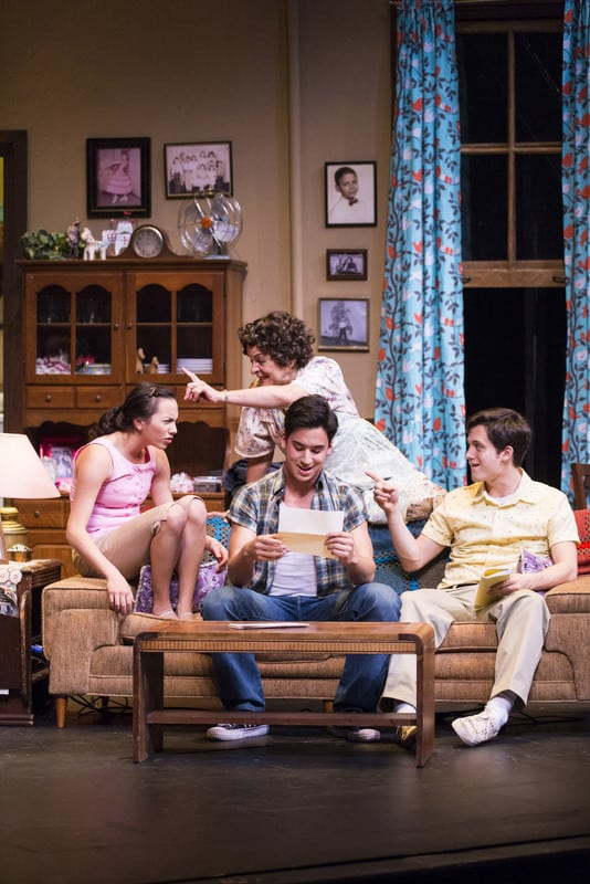 Alejandro (Michael Rosen, center) reads a letter from his father Pepe while his sister Rebecca (Michelle Cabinian, left), mother Inez (Priscilla Lopez, back), and brother Francisco (Eddie Gutierrez, right) listen in SOMEWHERE, playing Jan 16 - Feb 10, 2013 at TheatreWorks.