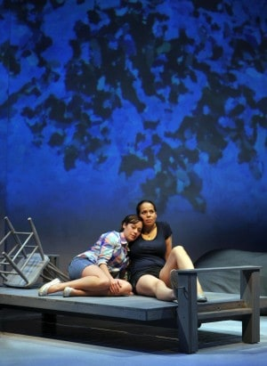 Suze (l. Blythe Foster) and Magz (r. Lauren Spencer) share a moment on the dock