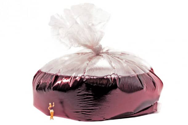 25,000 liter plastic bag used to ship wine: To drink, puncture carefully.