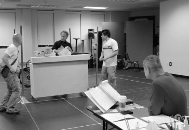 Director Chay Yew looks on as the cast of 'Stuck Elevator' rehearses. The show opens next moth at A.C.T. in San Francisco.