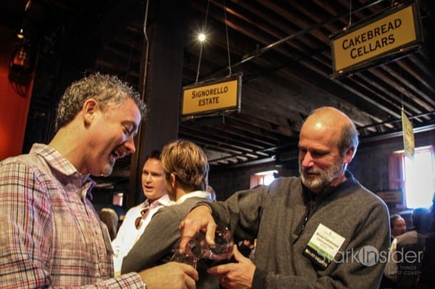 A scene from Premiere Napa Valley, an annual trade auction: Bruce Cakebread pours a 2010 Vaca Range Blend.