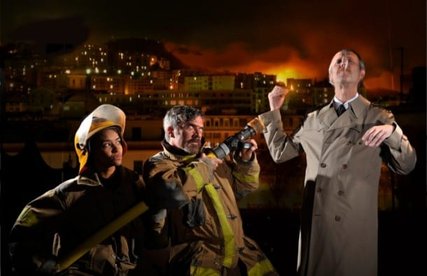 Firefighters (l, Tristan Cunningham, c, Kevin Clarke) try to stop Mr. Biedermann (r, Dan Hiatt) from lighting his cigarette in Aurora Theatre Company's The Arsonists