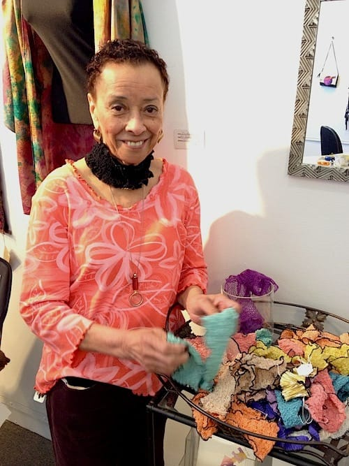 One of Torpedo's fiber artists, Gloria Barbre, with her magnetic scarves