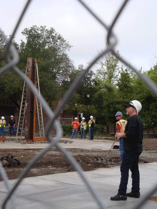 Artist Gordon Huether looks on during the installation of beams at the 9/11 Memorial in Napa.