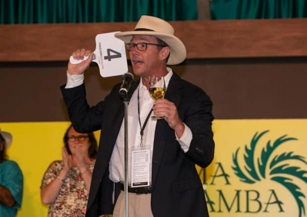 Matt Gallo, of the Gallo Family (2013 Sonoma Wine Country Weekend Honorary Vintner Chairs), motivates the crowd on stage at the Sonoma Harvest Wine Auction