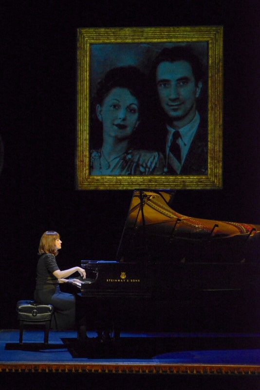 In The Pianist of Willesden Lane, award-winning pianist Mona Golabek plays the piano under a projected image of her parents, Lisa and Michel Golabek.