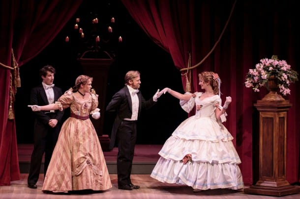 (l-r) Laurie (Matt Dengler) looks on in amusement and  Jo (Emily Koch) argues as John Brooke (Justin Buchs)  asks Meg (Sharon Rietkerk) to dance in  TheatreWorks' holiday musical LITTLE WOMEN,  playing December 4 - January 4 at the  Lucie Stern Theatre in Palo Alto.