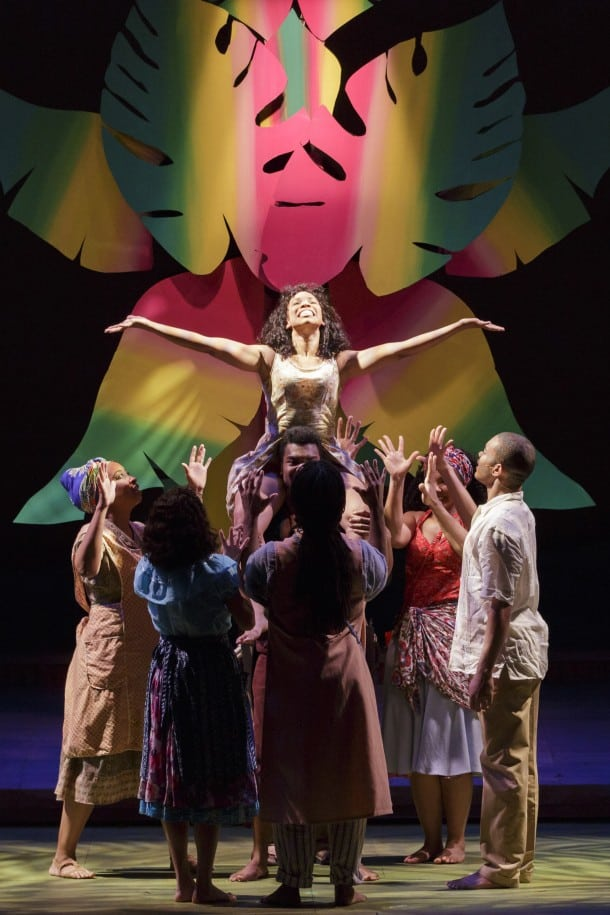 Ti Moune (Salisha Thomas) is lifted by the cast of  ONCE ON THIS ISLAND.