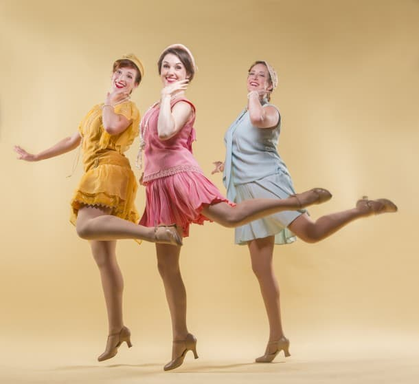 Melissa Reinertson, Jennifer Mitchell, and Andrea St. Clair kick up their heels.