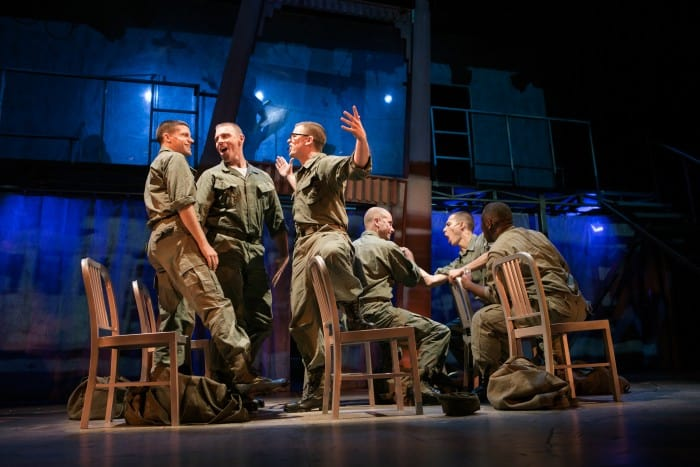 Marines (Jeffrey Brian Adams*, Brandon Dahlquist*, Andrew Humann, Andy Rotchadl, Nikita Burshteyn, and Aejay Mitchell) get ready for their last night on the town. Photo by Jessica Palopoli.