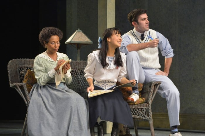(Left to right) Lily Miller (Margo Hall), Mildred Miller (Christina Liang), and Arthur Miller (Michael McIntire) listen to Nat Miller (not pictured) in Eugene O'Neill's Ah, Wilderness!, performing at A.C.T.'s Geary Theater through Sunday, November 8.