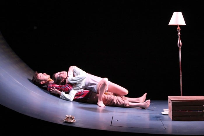 Ondine (Jessica Waldman) rests on Hildebrand (Kenny Toll) as they try to stay awake in Cutting Ball's World Premiere of Ondine. Photo: Rob Melrose