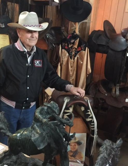Bill Holt proudly displays Tom Mix's saddle