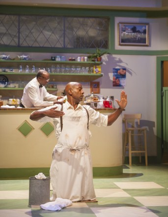 Sam (L. Peter Callender) sets up the tea room while Willie (Adrian Roberts) scrubs the floor and practices his ballroom form in Aurora Theatre Company's Master Harold…and the boys