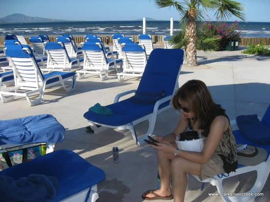 Loni Loreto BlackBerry poolside by the Inn at Loreto Bay with beautiful Sea of Cortez begging for attention in background